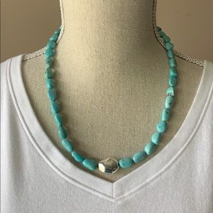 Turquoise necklace with silver medallion
